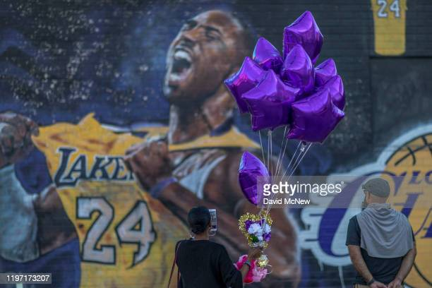Fans visit a mural of former NBA star Kobe Bryant who along with his 13yearold daughter Gianna died January 26 in a helicopter crash on January 28...