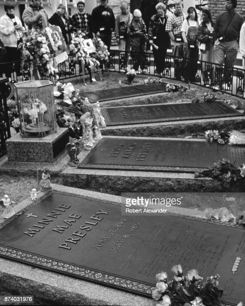 Fans visit the grave of singer Elvis Presley which is included in public tours of the late singer's mansion 'Graceland' in Memphis Tennessee...
