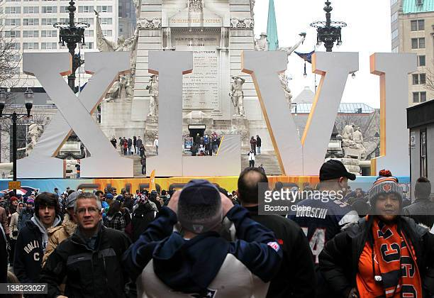 Fans visit the large Super Bowl Roman numeral display on Meridian Street in downtown Indianapolis