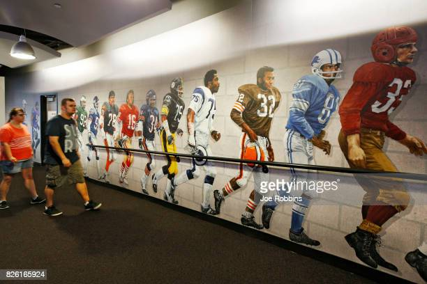 Fans visit the Pro Football Hall of Fame prior to the NFL season's inaugural preseason game between the Dallas Cowboys and Arizona Cardinals at Tom...