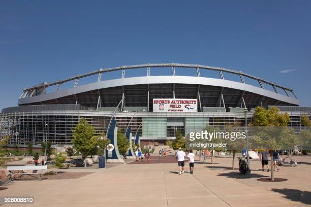 Fans visitors walk Sports Authority Field at Mile High Denver Colorado summer