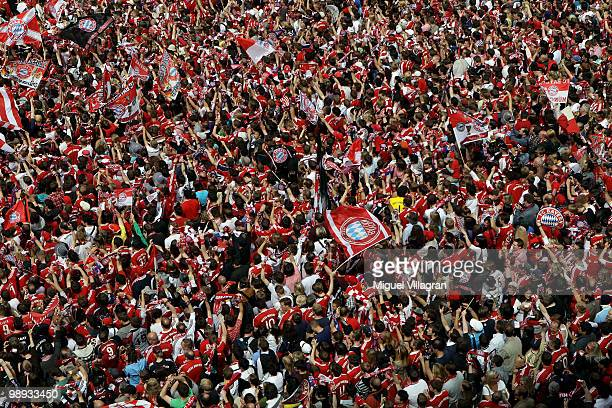 Fans wait at the town hall square for the player of Bayern Muenchen to present the German championship trophy on the balcony of the town hall during...