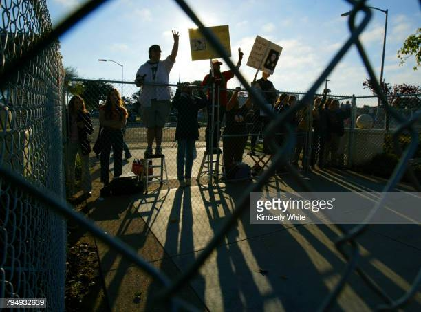 Fans wait behind security fences for the arrival of pop singer Michael Jackson at the Santa Barbara County Courthouse Santa Barbara Superior Court...