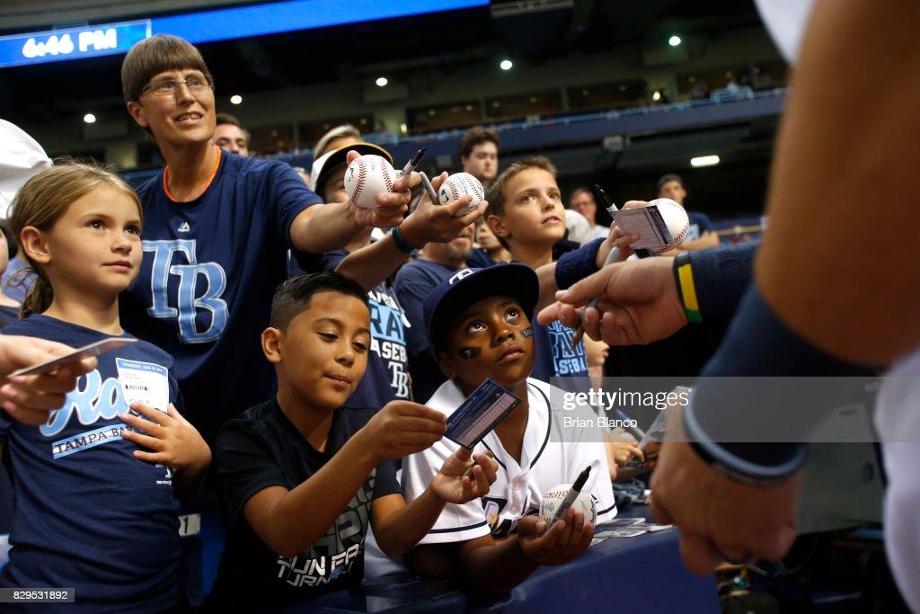 Fans wait for autographs from right fielder Steven Souza Jr. of the Tampa Bay Rays Rays before the start of a game against the Cleveland Indians on August 10, 2017 at Tropicana Field in St. Petersburg, Florida.