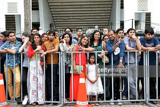 Fans wait for Bollywood stars to arrive to attend the final day of the 16th International Indian Film Academy Awards at the Putra Stadium in Kuala...