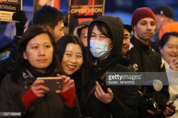Fans wait for celebrities prior to a screening of the European Premiere of Disney's MULAN at the Odeon Luxe Leicester Square cinema in London on...