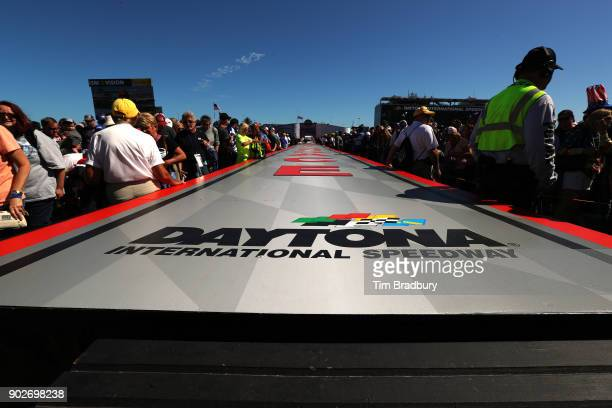 Fans wait for drivers to walk the driver's intros before 59th Annual DAYTONA 500 at Daytona International Speedway on February 26 2017 in Daytona...