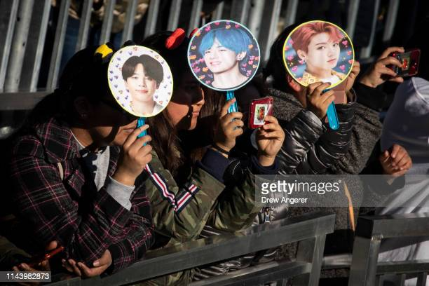 Fans wait for K-Pop group BTS to take the stage in Central Park, May 15, 2019 in New York City. Fans waited in line for days to see the group perform...