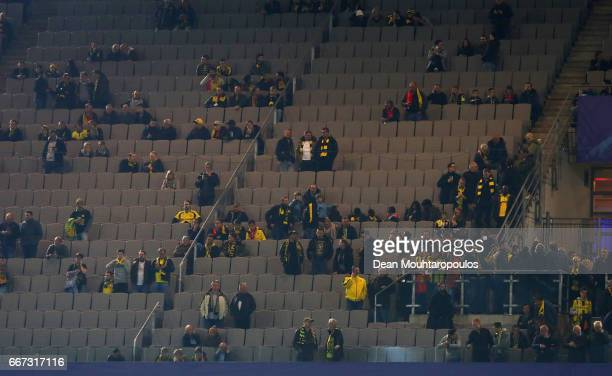 Fans wait for news inside the stadium after an explosion near the Borussia Dortmund team coach prior to the UEFA Champions League Quarter Final first...