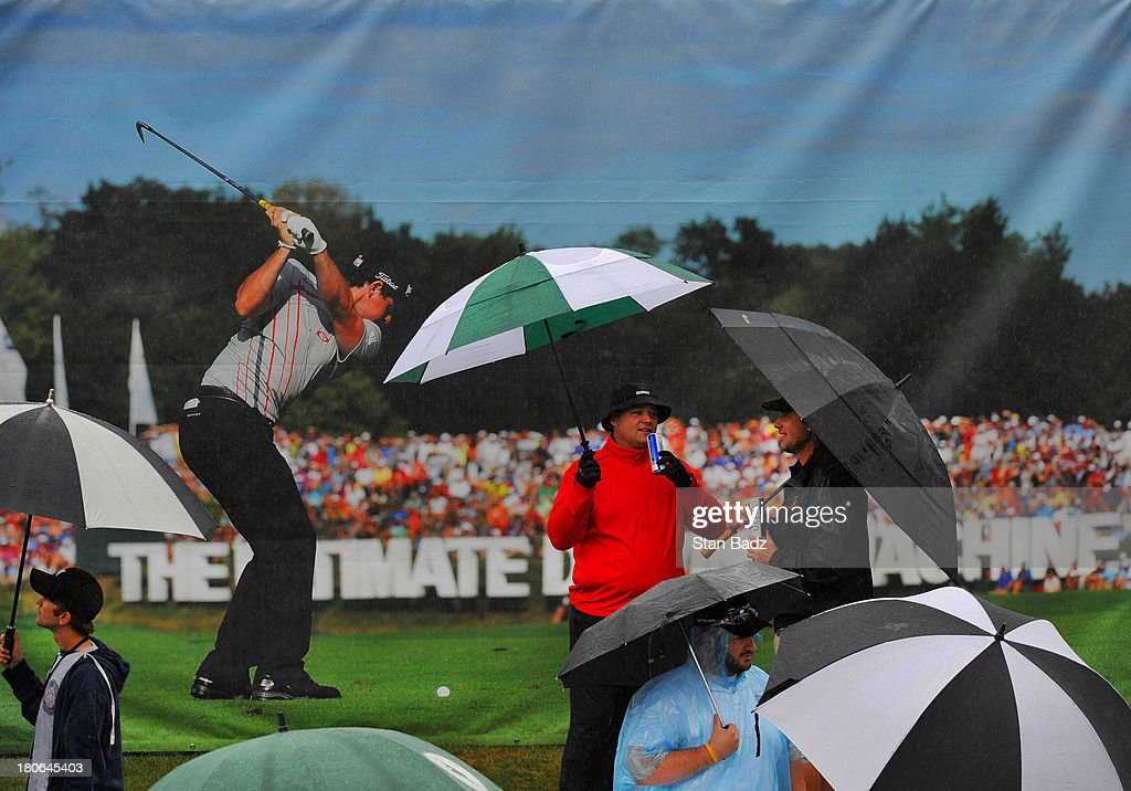 Fans wait for play to resume during a second rain delay during the final round of the BMW Championship at Conway Farms Golf Club on September 15, 2013 in Lake Forest, Illinois.