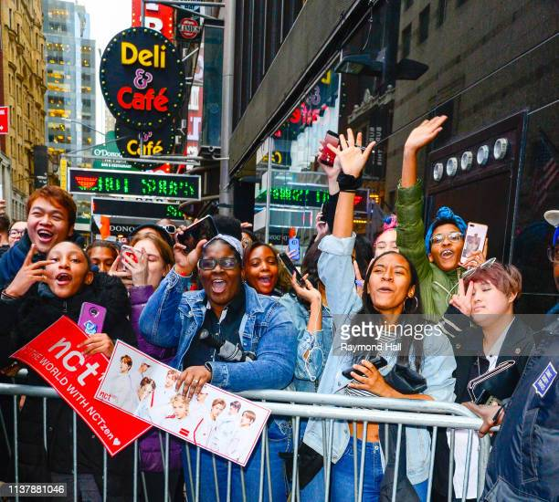 Fans wait for South Korean Boy group NCT 127 outside Good Morning America on April 18 2019 in New York City