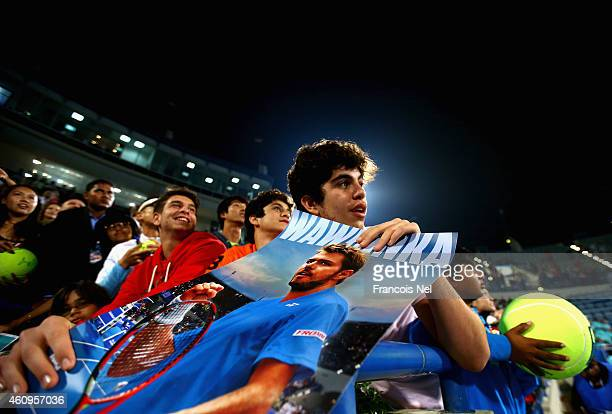 Fans wait for Stanislas Wawrinka of Switzerland to sign autographs after he won his first round match against Nicolas Almagro of Spain during day one...