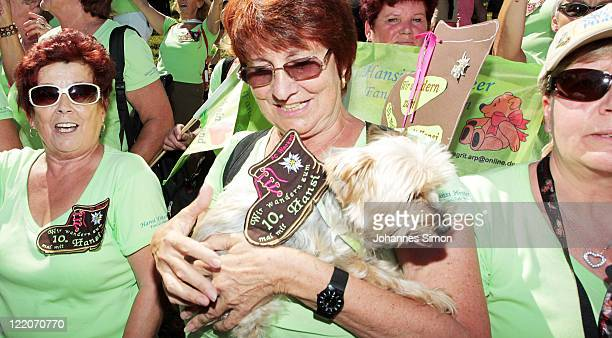 Fans wait for the arrival of Austrian singer Hansi Hinterseer ahead of the annual Hansi Hinterseer fan hiking tour on August 25, 2011 in Kitzbuehel,...