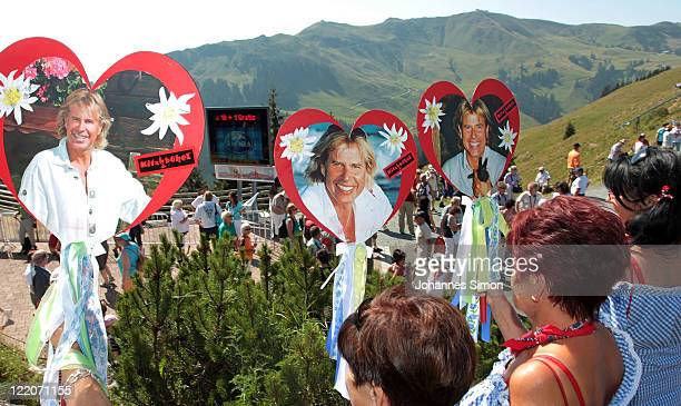 Fans wait for the arrival of Austrian singer Hansi Hinterseer to start his annual fan hiking tour beginning at the peak of the Hahnenkamm mountain on...