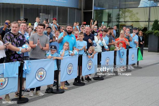 Fans wait for the arrival of new Manchester City signing Riyad Mahrez at the Etihad Stadium Manchester