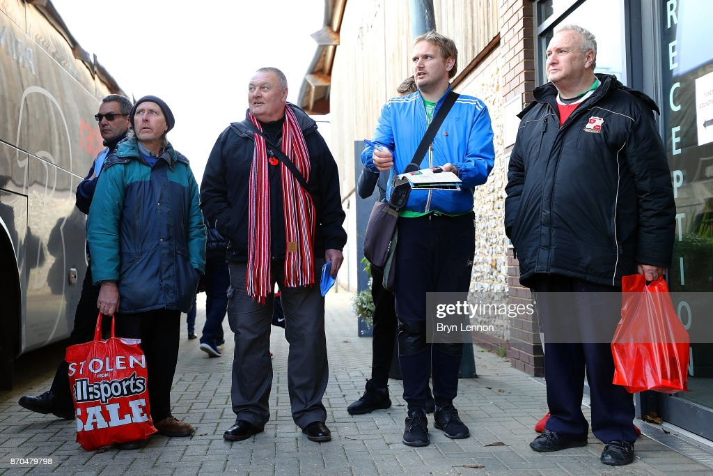 Fans wait for the players to arrive for the The Emirates FA Cup first round match between Dartford and Swindon Town at the Princes Park Stadium on November 5, 2017 in Dartford, England.