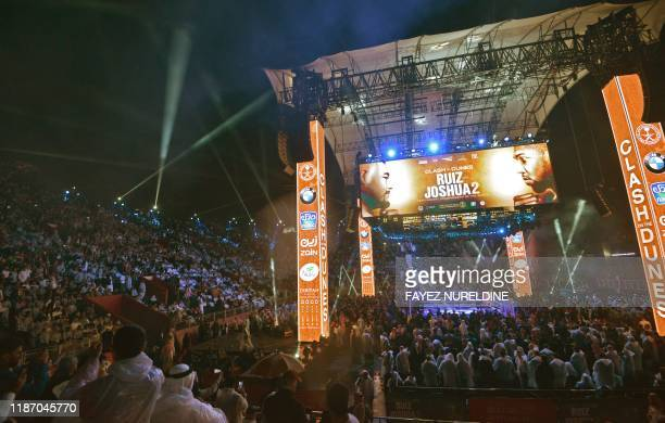 Fans wait for the start of the heavyweight boxing match between Andy Ruiz Jr and Anthony Joshua for the IBF WBA WBO and IBO titles in Diriya near the...