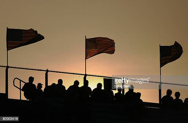 Fans wait for the start of the NASCAR Nationwide Series MissouriIllinois Dodge Dealers 250 as the sun sets on July 19 2008 at Gateway International...
