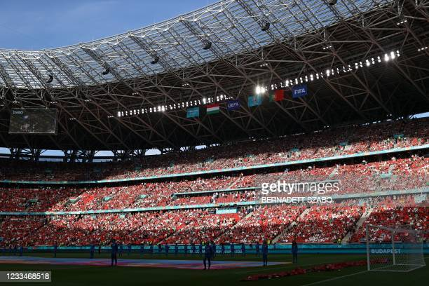 Fans wait for the start of the UEFA EURO 2020 Group F football match between Hungary and Portugal at the Puskas Arena in Budapest on June 15, 2021.