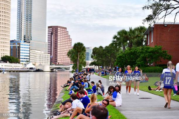 Fans wait for the Tampa Bay Lightning boat parade to celebrate the Stanley Cup on the Hillsborough river from the University of Tampa on September...