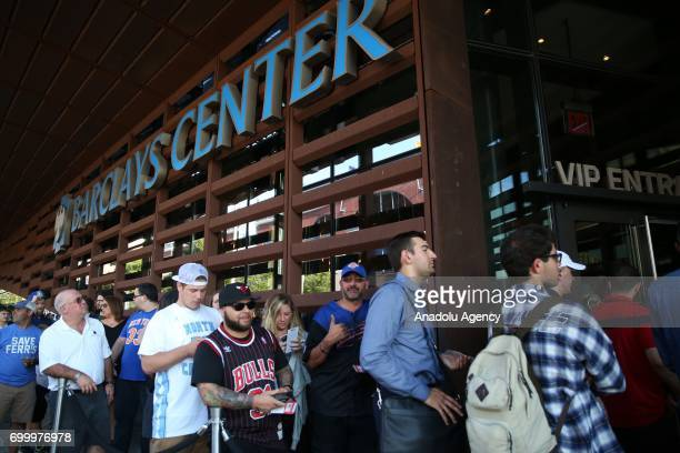 Fans wait in lanes to enter Barclays Center to attend NBA Draft 2017 in Brooklyn borough of New York United States on June 22 2017