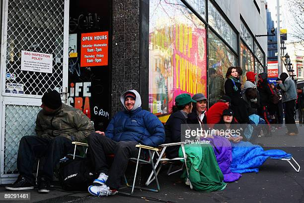 Fans wait in line after spending a night outside Real Groovy Records to buy tickets for AC/DC's 2010 Auckland Concert on July 28, 2009 in Auckland,...