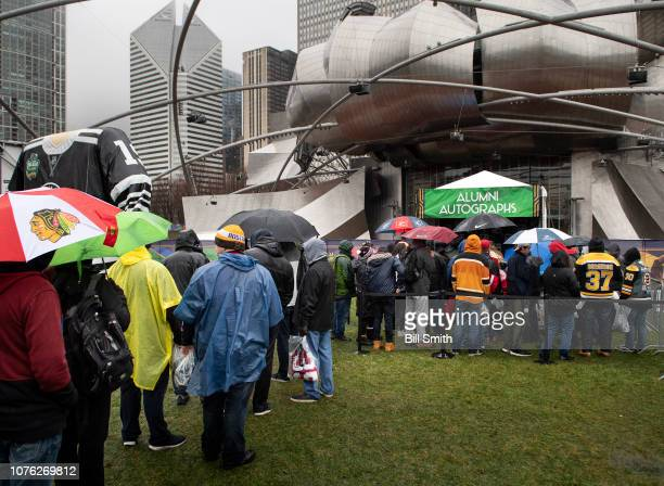 Fans wait in line at the Bridgestone NHL Winter Classic Park fan festival at Millenium Park on December 31 2018 in Chicago Illinois