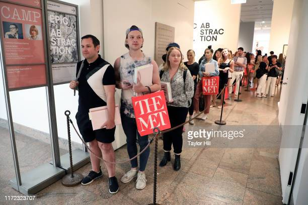 """Fans wait in line for Anna Wintour and Andrew Bolton to sign their copies of the """"Camp: Notes on Fashion"""" exhibition catalogue at Metropolitan Museum..."""