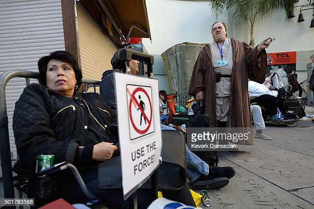 Fans wait in line for the opening night of Walt Disney Pictures and Lucasfilm's Star Wars The Force Awakens at TCL Chinese Theater IMAX on December...