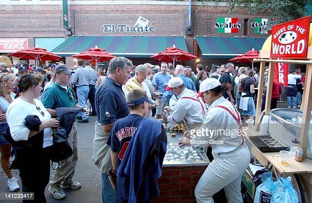 Fans wait in line to buy a pregame beer on Yawkey Way