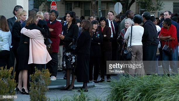 Fans wait in line to pay their respects to James Dungy outside Wilson Funeral Home on December 26 2005 in Tampa Florida More than 1000 people came to...