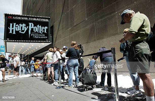 Fans wait in line to see 'Harry Potter' which will show the trailer for 'The Polar Express' at Loews Astor Plaza in Times Square June 4 2004 in New...
