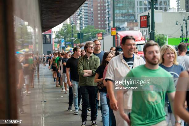 Fans wait in long lines to enter the Foo Fighters concert at Madison Square Garden on June 20, 2021 in New York City. The Foo Fighters concert is the...
