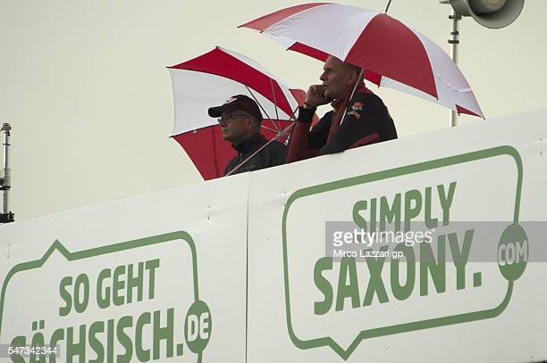 Fans wait in pit the riders under the rain during the MotoGp of Germany Preview at Sachsenring Circuit on July 14 2016 in HohensteinErnstthal Germany