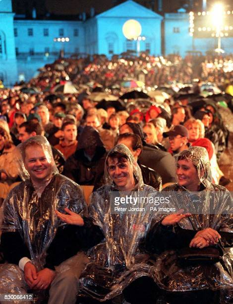 Fans wait in the rain for Mike Oldfield's performance during the launch of his Tubular Bells 3 album at Horse Guards Parade in London this evening...