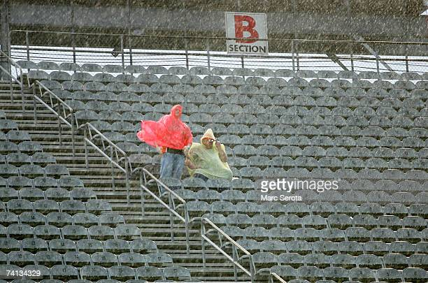 Fans wait in the stands during heavy rain, prior to the NASCAR Nextel Cup Series Dodge Avenger 500 on May 12, 2007 at Darlington Raceway in...