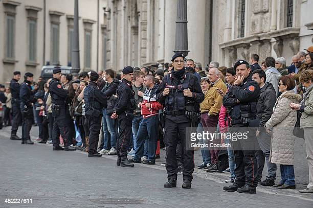 Fans wait in the street for the arrival of Queen Elizabeth II on April 3 2014 in Rome Italy During their brief visit The Queen and the Duke of...