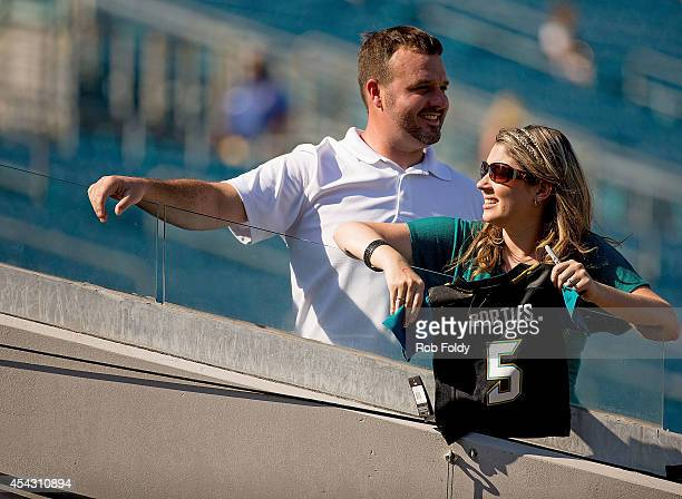 Fans wait near the players tunnel holding a jersey of Blake Bortles of the Jacksonville Jaguars defore the game against the Atlanta Falcons at...