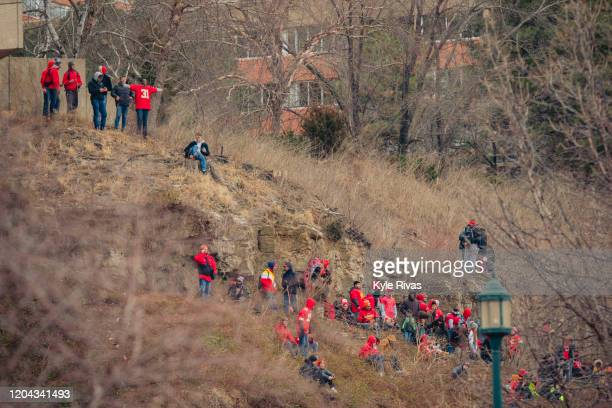 Fans wait on a nearby hillside while waiting for the Kansas City Chiefs Victory Parade on February 5 2020 in Kansas City Missouri