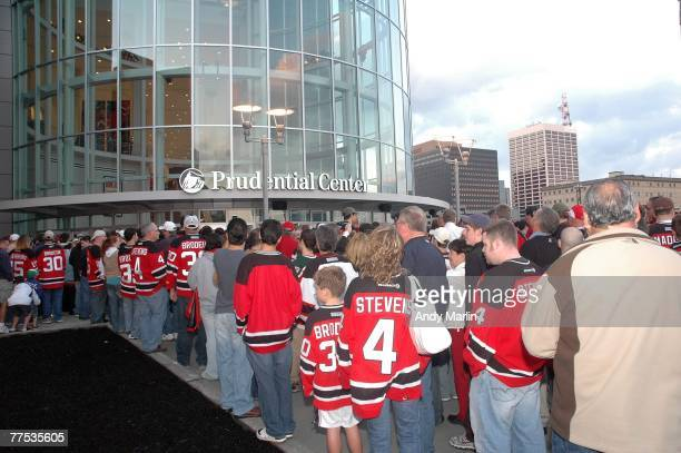 Fans wait on line for the doors to open for opening night of the Prudential Center prior to the game between the New Jersey Devils and the Ottawa...