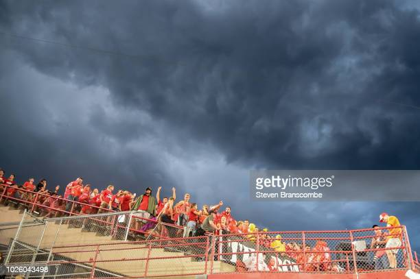 Fans wait out a weather delay in the game between the Nebraska Cornhuskers and the Akron Zips at Memorial Stadium on September 1, 2018 in Lincoln,...