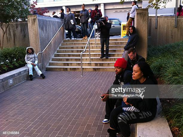Fans wait outside DC Superior Court waiting for Chris Brown to emerge following his hearing in Washington DC on October 28 2013
