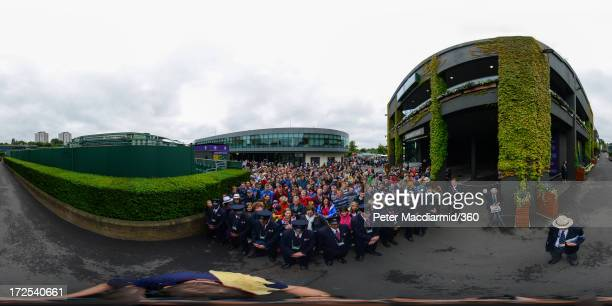 Fans wait outside of Centre Court for players to arrive on day nine of the Wimbledon Lawn Tennis Championships at the All England Lawn Tennis and...