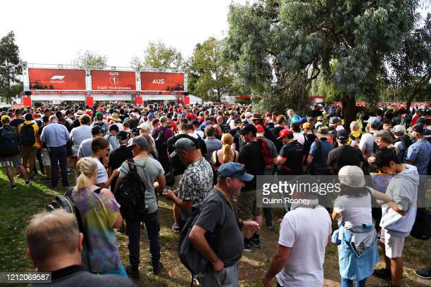 Fans wait outside of the gates before practice for the F1 Grand Prix of Australia at Melbourne Grand Prix Circuit on March 13 2020 in Melbourne...