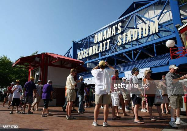 Fans wait outside Rosenblatt Stadium to watch Game Three of the 2009 NCAA College World Series between the Texas Longhorns and the Louisiana State...