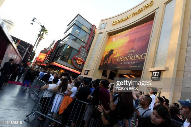 "Fans wait outside the Dolby theatre as guests arrive for the world premiere of Disney's ""The Lion King"" on July 9, 2019 in Hollywood."