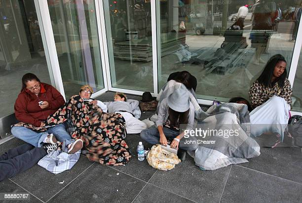 Fans wait outside the Michael Jackson public memorial service held at Staples Center on July 7, 2009 in Los Angeles, California. Jackson the iconic...
