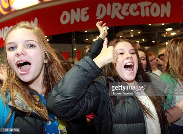 Fans wait outside the official One Direction merchandise store on April 20 2012 in Wellington New Zealand The 1D fan store will sell official...