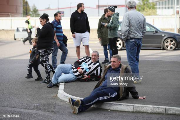 Fans wait outside the stadium prior to the Premier League match between Southampton and Newcastle United at St Mary's Stadium on October 15 2017 in...