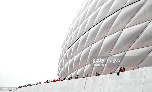 Fans wait outside the stadium prior to the UEFA Champions League quarter final first leg match between FC Bayern Muenchen and SL Benfica at Allianz...